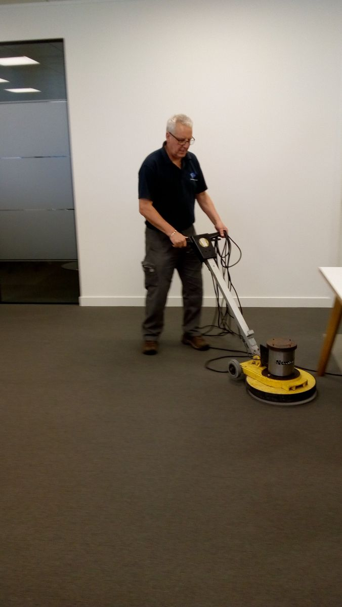 John from LDM Services cleaning office carpets